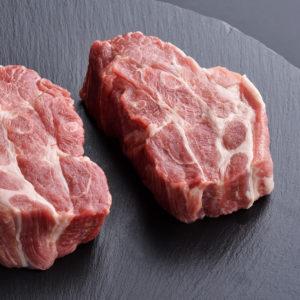 Two fresh raw boneless pork shoulder butt slices